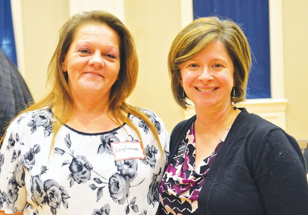 Photo by Nancy Shirley    Dr. Amy Wilson, right, medical director for the Community Care Clinic, helped clinic patient Leighanne Smith, left, in finding a cure for her hepatitis C. Smith spoke Monday at the Community Thanks event.