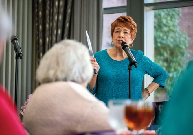 JON C. LAKEY/SALISBURY POST Mary Ann McCubbin entertains the attendees.  The annual Fashions for a Cause  was held at the Crystal Lounge at Catawba College on  Wednesday, April 10, benefitting Community Care Clinic. Salisbury, NC 4/10/19